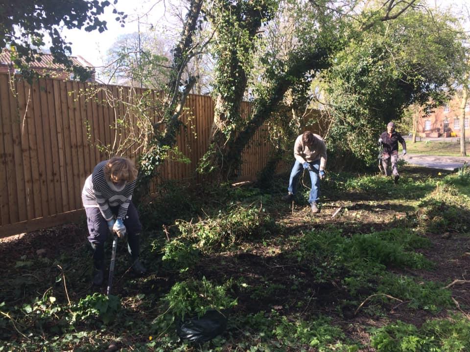 Volunteers preparing land for restoring hedge line